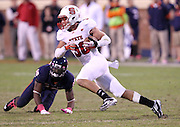 Oct. 22, 2011 - Charlottesville, Virginia - USA; North Carolina State Wolfpack safety Brandan Bishop (30) runs past Virginia Cavaliers wide receiver Kris Burd (18) during an NCAA football game at the Scott Stadium. NC State defeated Virginia 28-14. (Credit Image: © Andrew Shurtleff