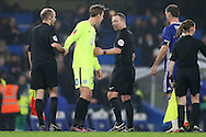 Referee Kevin Friend talking to Martin Samuelsen of Peterborough United after full time. The Emirates FA cup, 3rd round match, Chelsea v Peterborough Utd at Stamford Bridge in London on Sunday 8th January 2017.<br /> pic by John Patrick Fletcher, Andrew Orchard sports photography.