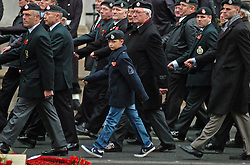 (c) London News Pictures. 13/11/2010. A young boy joins Veterns to march past the Cenotaph to pay thier respects to fallen comrades. The Queen today (Sun) led the Remembrance Sunday service at the Cenotaph in London in honour of those who have died in wars and conflicts. Picture credit should read: Will Oliver/London News Pictures