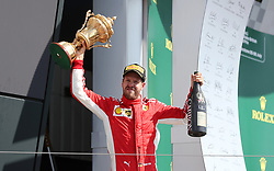 Ferrari's Sebastian Vettel celebrates victory during the 2018 British Grand Prix at Silverstone Circuit, Towcester.