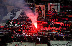 Flares light up the stands at the FC Basel fans' end