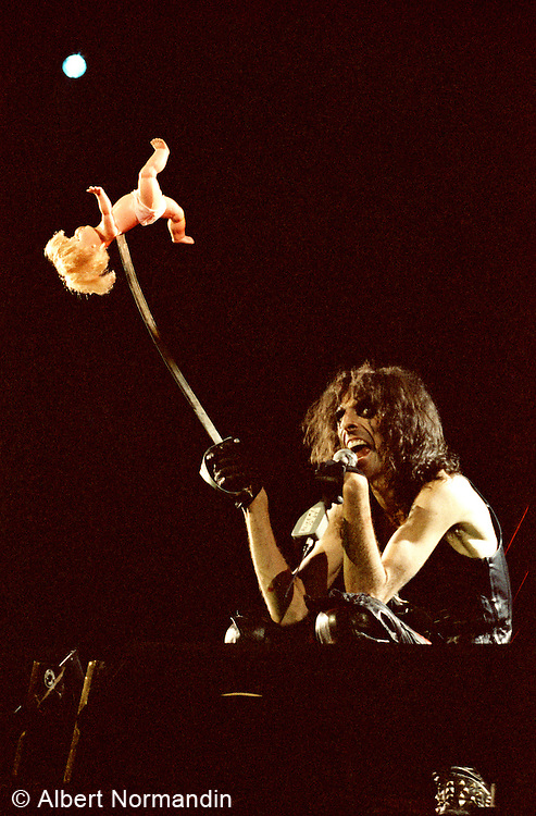 Alice Cooper with a baby doll on sword