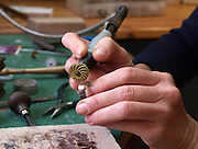 Jeweller polishes a hand made ring