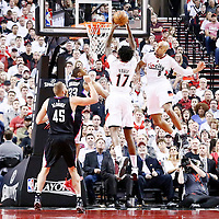 25 April 2016: Portland Trail Blazers center Ed Davis (17) grabs the rebound next to Portland Trail Blazers guard Gerald Henderson (9), over Los Angeles Clippers forward Wesley Johnson (33) during the Portland Trail Blazers 98-84 victory over the Los Angeles Clippers, during Game Four of the Western Conference Quarterfinals of the NBA Playoffs at the Moda Center, Portland, Oregon, USA.
