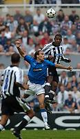 Fotball<br /> Treningskamper England<br /> 31.07.2004<br /> Foto: SBI/Digitalsport<br /> NORWAY ONLY<br /> <br /> Newcastle United v Glasgow Rangers<br /> <br /> Newcastle's Titus Bramble (R) beats Rangers' Dado Prso to the ball.