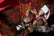 Tella Bu, youngest daughter of the late Khan, washing dishes..Daily life at the Khan (chief) autumn camp (called Teramo Jai - place of Autumn), beside the Aksu river...Trekking through the high altitude plateau of the Little Pamir mountains (average 4200 meters) , where the Afghan Kyrgyz community live all year, on the borders of China, Tajikistan and Pakistan.