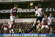 Jan Vertonghen of Tottenham Hotspur ® heads the ball over Andy Carroll of West Ham United. Barclays Premier league match, Tottenham Hotspur v West Ham Utd at White Hart Lane in London on Sunday 22nd November 2015.<br /> pic by John Patrick Fletcher, Andrew Orchard sports photography.
