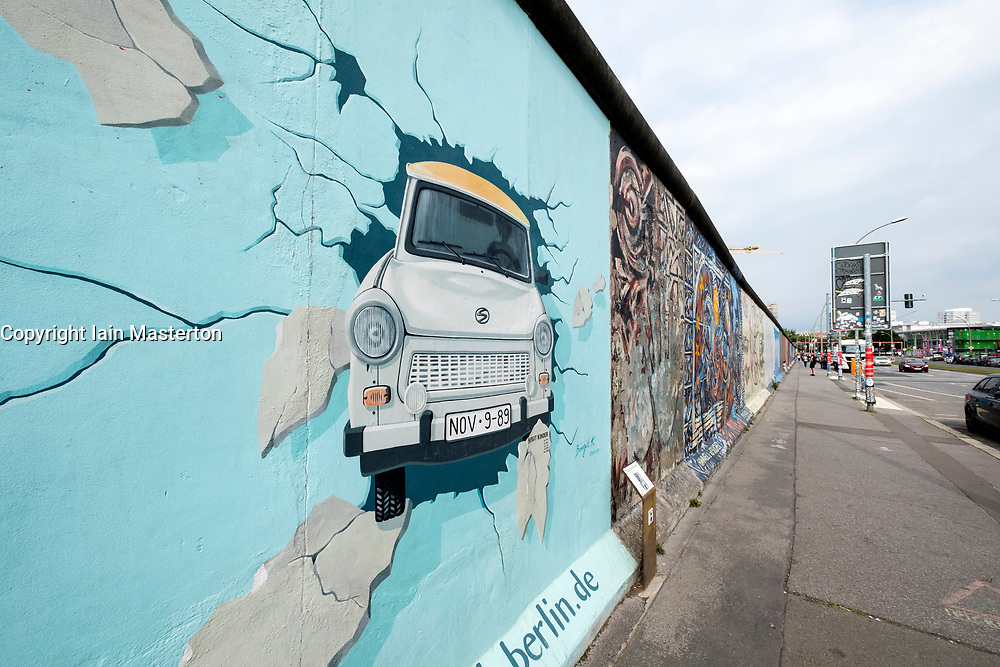 Trabant mural painted on original section of Berlin Wall at East Side gallery in Berlin, Germany ...Editorial Use Only