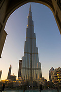 The famous Burj Khalifa, the tallest building in the world, as of 2021 in Dubai, United Arab Emirates as seen from an archway in the Souk Al Bahar