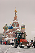 Moscow, Russia, 20/02/2005..Pedestrians and traffic pass piles of snow being cleared from blocking the city streets.