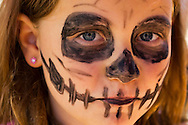 Sept. 9, 2012 - Merrick, New York, U.S. -  A skeleton is what this girl wearing pink flower earrings had her face painted as, at the 22nd Annual Merrick Festival on Long Island.