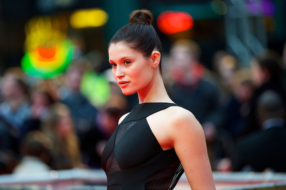 """Actress Gemma Arterton attends the world premiere of """"The Clash of the Titans,"""" a remake of the 1981 film, at Empire Leicester Square, London.  With a narrative inspired by the Greek myth of Perseus, Leicester Square was transformed into a ancient Greek setting, complete with a legion of soldiers, columns and scultpture ruins."""
