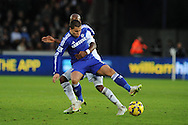 Eden Hazard of Chelsea holds off Swansea's Dwight Tiendalli. Barclays Premier League match, Swansea city v Chelsea at the Liberty Stadium in Swansea, South Wales on Saturday 17th Jan 2015.<br /> pic by Andrew Orchard, Andrew Orchard sports photography.