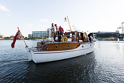 © Licensed to London News Pictures. 16/05/2015. London, UK. Dunkirk Little Ship, Papillon parades in Royal Victoria Dock this evening. Over 20 Dunkirk Little Ships have gathered in London toay before leaving in the morning to continue their journey to Dunkirk to mark the 75th anniversary of the Dunkirk Evacuations. Photo credit : Vickie Flores/LNP