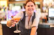 Bartender Cris displays the Streetcar Martini