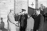 20/12/1963<br /> 12/23/1963<br /> 20 December 1963<br /> Last passing out parade of Gardai at the Garda Depot Phoenix Park, Dublin. Ballymacoda, Co. Cork Recruit J. Lawton is congratulated by his father and mother, Mr and Mrs Thomas Lawton, and his cousin, Patrick O'Donoghue.