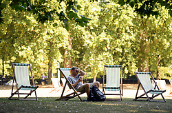 © Licensed to London News Pictures. 23/07/2018. London, UK. A man wipes sweat from his forehead while sheltering in the shade in St James's Park central London, as the hot weather continues in the capital. Forecasters are predicting record temperatures this week. Photo credit: Ben Cawthra/LNP