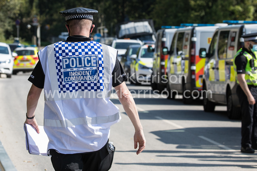 A Hertfordshire Police Incident Commander oversees a policing operation to remove HS2 Rebellion activists who had used a lock-on arm tube to block a gate to the South Portal site for the HS2 high-speed rail link on 14 September 2020 in West Hyde, United Kingdom. Anti-HS2 activists blocked two gates to the same works site for the controversial £106bn rail link, one remaining closed for over six hours and another for over nineteen hours.