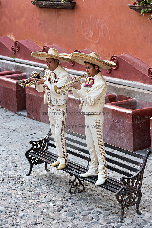 A traditional Mexican mariachi band plays during a wedding celebration in the Lavaderos del Chorro park in San Miguel de Allende, Guanajuato, Mexico.