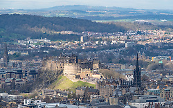 Looking towards Edinburgh Castle in sunlight from Arthur's Seat in Edinburgh, Scotland, UK