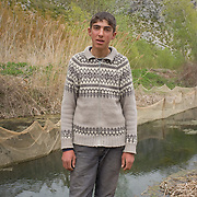 Mateo Kape (18) from Tren at the very end of small Prespa lake, Albania