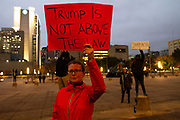 """Myla Johnson from Dallas holds a sign in protest against President Trump's firing of Attorney General Jeff Sessions. Johnson  sees the move as jeopardizing Democracy and creating a Constitutional crisis. The protest is part of a nationwide campaign designed to protest Trump's crossing a """"red line"""" in attempting to stop Special Robert Mueller's investigation into the WH."""