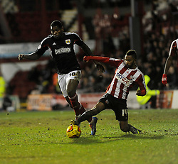 Bristol City's Jay Emmanuel-Thomas is challenged by Brentford's Shaleum Logan - Photo mandatory by-line: Dougie Allward/JMP - Tel: Mobile: 07966 386802 28/01/2014 - SPORT - FOOTBALL - Griffin Park - Brentford - Brentford v Bristol City - Sky Bet League One
