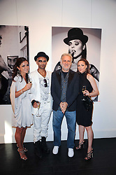 Left to right, ANNASTASIA HATZVASILOU, photographer ZOOBS, artist MARCO LODOLA and GEORGIA ZARIS at a private view of an exhibition of work by artists Zoobs and Lodola held at The Opera Gallery, 134 New Bond Street, London on 16th June 2010.