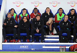 Liverpool manager Jurgen Klopp (left), players and staff sit dejected on the bench during the Carabao Cup, third round match at the King Power Stadium, Leicester.