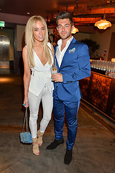 NICOLA HUGHES and ALEX MYTTON at the Fashion Targets Breast Cancer 20th Anniversary Party held at 100 Wardour Street, Soho, London on 12th April 2016.