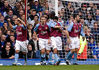 Fotball<br /> Premier League 2004/2005<br /> 06.11.2004<br /> Foto: SBI/Digitalsport<br /> NORWAY ONLY<br /> <br /> Aston Villa v Portsmouth<br /> <br /> Aston Villa players celebrate Nolberto Solano's goal, their side's third of the first half.