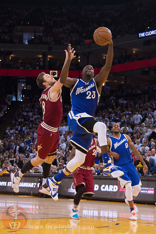 December 25, 2015; Oakland, CA, USA; Golden State Warriors forward Draymond Green (23) reaches for a pass against Cleveland Cavaliers guard Matthew Dellavedova (8) during the fourth quarter in a NBA basketball game on Christmas at Oracle Arena. The Warriors defeated the Cavaliers 89-83.