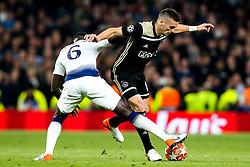 Dusan Tadic of Ajax takes on Davinson Sanchez of Tottenham Hotspur - Mandatory by-line: Robbie Stephenson/JMP - 30/04/2019 - FOOTBALL - Tottenham Hotspur Stadium - London, England - Tottenham Hotspur v Ajax - UEFA Champions League Semi-Final 1st Leg