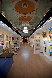 © Licensed to London News Pictures. 19/04/2012. London, U.K..The Setting up of The Chelsea Art Fair in Chelsea Old Town Hall where Around 35 galleries and dealers offer modern British and contemporary art for sale, including paintings, drawings, etchings and sculptures. Represents 500 international artists, with art worth up to £20k. The fair runs from 19th April - 22nd April..Photo credit : Rich Bowen/LNP