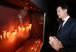 © Licenced to London News Pictures. 29/01/2014. London. UK.  <br /> Deputy Prime Minister Nick Clegg is pictured admiring the artefacts at a 'Beyond El Dorado: power and gold in ancient Colombia' exhibition at the British Museum in London, January 29th 2014. The leader of the Liberal Democrat Party is joined by representatives from the Mexican and Colombian Embassies ahead of his trade and investment visit to Colombia and Mexico next week.<br /> Photo Credit: Susannah Ireland