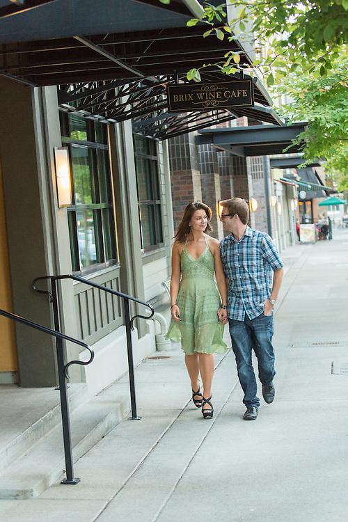 United States, Washington, Kirkland, young couple walking by cafe.  MR, PR