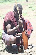 Africa, Tanzania, Lake Eyasi, Maasai man preparing blood milk with blood drawn from a cow. an ethnic group of semi-nomadic people February 2006