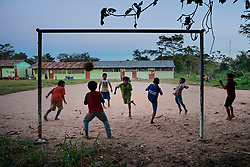 NO WEB/NO APPS - Exclusive. (Text available) A group of kids are playing football after their classes, in 'Palma Real' native community, near Puerto Maldonado, Peru on July 17, 2017. The Amazon rainforest is famous as 'The Lung of the Earth', but also for the presence of numerous native communities, who have always lived isolated and in close contact with nature for generations, used to seek for food and medicines and to build items directly from the environment in which they live. The unstoppable rise of globalization has drastically changed their needs, expectations and consequently their way of life. Located in the Tambopata National Reserve, on the border between Peru and Bolivia, the native Comunidad Palma Real is one of the clearest examples of this change. Living on the banks of the Madre de Dios River since approximately 1976, Palma Real comprises about 300 people part of the nomadic community Ese-Eja, established in the Amazon rainforest of Peru before the Spanish colonization. Photo by Giacomo d'Orlando/ABACAPRESS.COM