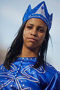 Female Cuban young woman of mixed descendancy posing for a portrait wearing colourful costume, performance in Havana old town, local dance and theatre group enacting the slave trade, colonial rule and how African religion and beliefs continuing, becoming what is now Santeria.