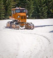 orange Tucker Sno Cat tracked snow vehicle at Mount Tahoma Trails, Ashford, WA, USA