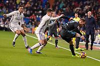 Real Madrid's Lucas Vazquez and Danilo Luiz Da Silva and Real Sociedad's David Zurutuza during La Liga match between Real Madrid and Real Sociedad at Santiago Bernabeu Stadium in Madrid, Spain. January 29, 2017. (ALTERPHOTOS/BorjaB.Hojas)