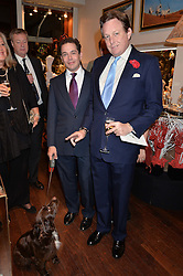 Left to right, LUIS MIGUEL HOWARD and LORD VALENTINE CECIL and dog Coco at a pre christmas party & shopping evening at Patrick Mavros, 104-106 Fulham Road, London on 26th November 2014.