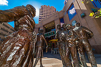"""A poured bronze public art sculpture in Albuquerque Plaza, """"Sidewalk Society"""" by Glenna Goodacre, a collection of nine figures standing on a corner in Downtown Albuquerque, New Mexico USA"""