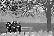 Loos British Cemetery, Loos, Pas de Calais, France.Re-Interrement of 20 British Soldiers. March 2014<br /> Seen Here: Almost 100 years after they were killed in action in the battle of Loos in Northern France during WW1, twenty British Soldiers were re-interred in the Commonwealth War Graves Commission Loos British Cemetery after their remians were found in 2010 during construction of new buildings at Vendin-le-Vieil, north of Arras.<br /> Private William McAleer from the 7th Battalion the Royal Scottish Fusiliers was found with his identity disc, but it was not possible to identify the other nineteen soldiers who were buried as soldiers 'Known unto God'. Private McAleer was carried into the cemetery in a coffin covered with the Union Jack flag. The 19 unidentified soldiers were placed in 4 coffins and buried  prior to the burial of William McAleer.