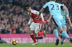 22 January 2017 London : Premier League Football : Arsenal v Burnley :<br /> Mesut Ozil of Arsenal has his shirt pulled by a Burnley defender.<br /> Photo: Mark Leech
