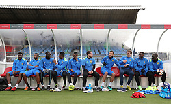 Sutton United players sit in the dugout during the training session at Gander Green Lane, London.