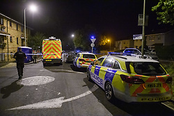 © Licensed to London News Pictures. 08/10/2021. Oxford, UK. Thames Valley Police vehicles parked at the crime scene cordon in Bayswater Road, Barton in Oxfordshire. Police were called just before 6:00pm today, Friday 08/10/2021, to reports of a man being stabbed, the victim, a man aged in his thirties, died of his injuries at the scene. Photo credit: Peter Manning/LNP