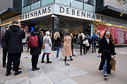 Asthe national lockdown ends and the new three tier system of local coronavirus restrictions begins, shoppers head out to Oxford Street queueing outside Debenhams which has just announced that the department store chain will be closing down for good are allowed to reopen on 2nd December 2020 in London, United Kingdom. Debenhams has been an ever present feature all over the UK for 242 years, but it has been announced that it will close all of its shops at the cost of around 12,000 jobs, and go into liquidation. This huge blow to the high street has not come as a surprise as the company has been struggling for some time.