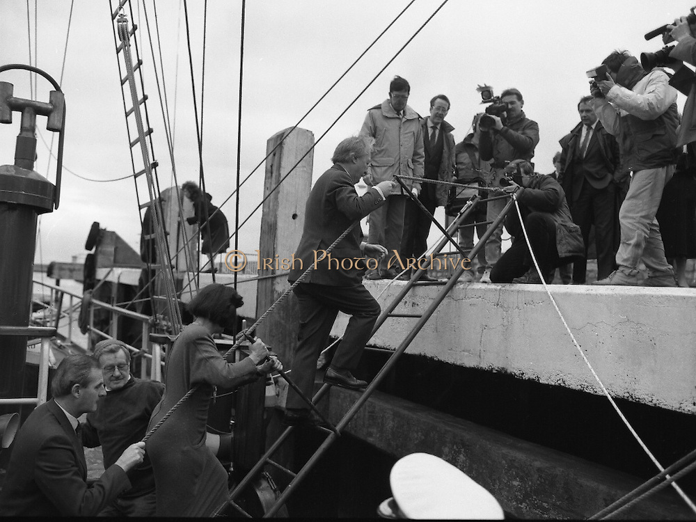 Asgard II departs for Australia.   (R66)..1987..15.10.1987..10.15.1987..15th October 1987..The Asgard II training ship departed from the National Yacht Club in Dun Laoghaire en route to Australia. The Asgard II was a purpose built training brigantine built by Jack Tyrrell in Wicklow. On hand to sent the Asgard Ii on her way was An Taoiseach, Mr Charles Haughey, and Mr Frank Milne the Australian Ambassador to Ireland...Image shows An Taoiseach, Mr Charles Haughey TD, disembarking the Asgard II as she prepares to set sail for Australia.