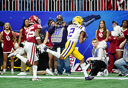 LSU Tigers wide receiver Justin Jefferson (2) catches pass for a touchdown as Oklahoma Sooners safety Justin Broiles (25) defends during the first half against in the 2019 College Football Playoff Semifinal at the Chick-fil-A Peach Bowl on Saturday, Dec. 28, in Atlanta. (Vasha Hunt via Abell Images for the Chick-fil-A Peach Bowl)